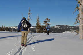 Image of skiers returning to Fisher Lake Overlook from Peak 7260