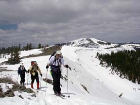Image of skiers on ridge with Mt. Lincoln in backtground