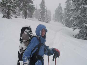 Image of daughter carrying pack into Ostrander Hut